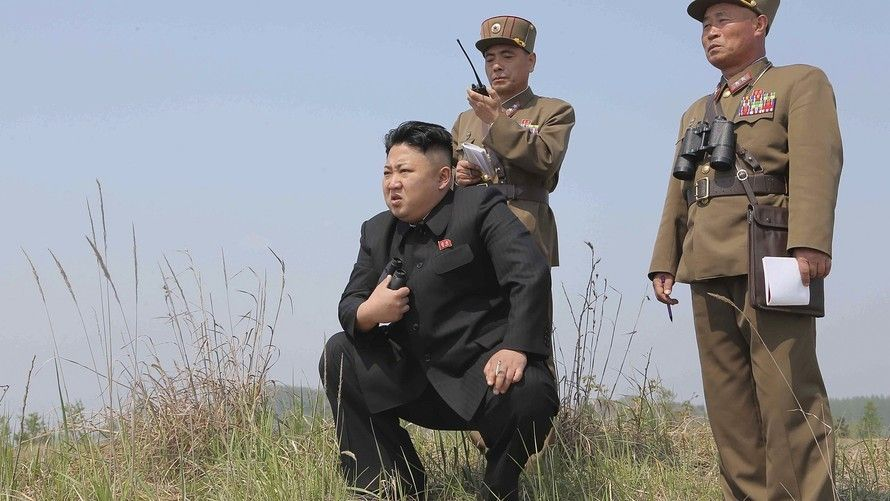 Kim Jong-un seen with soldiers, holding his binoculars