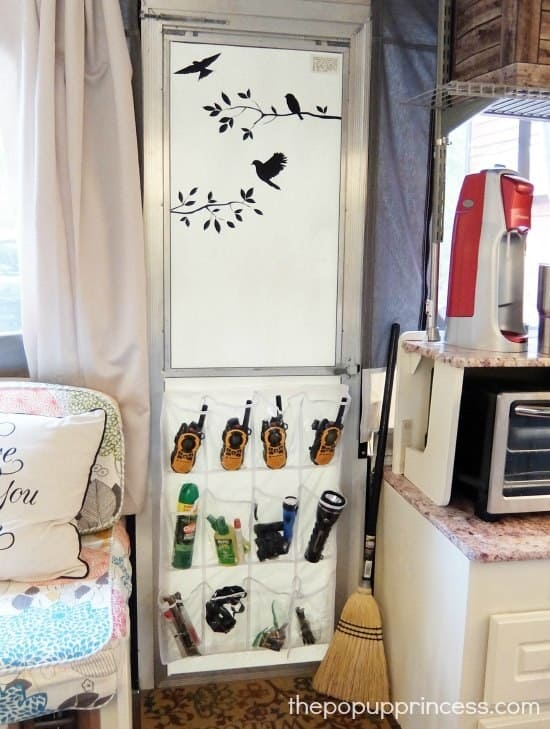 11. Hang a shoe organizer for essentials like walkie-talkies, bug sprays, and late-night flash lights.