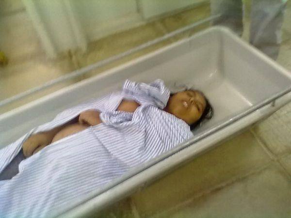 A dead woman gave birth to a baby.