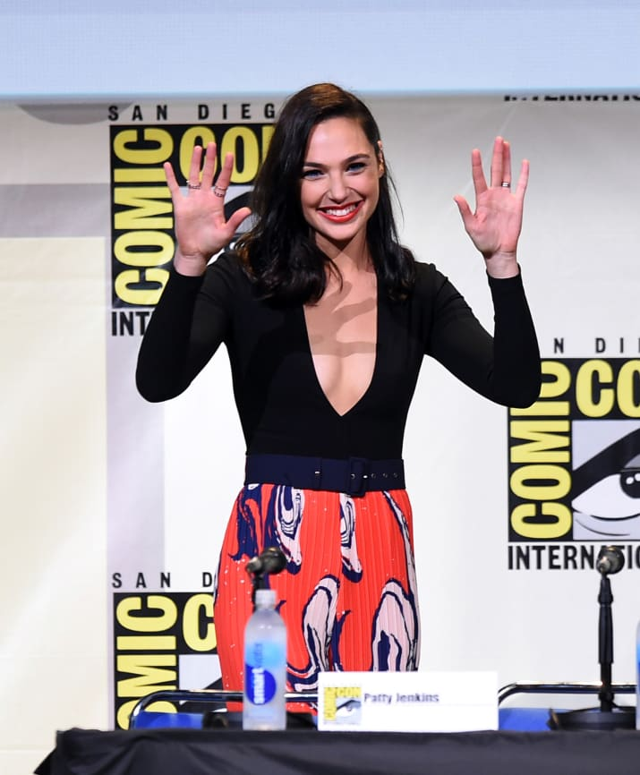 14. This is Gal Gadot waving with two hands.