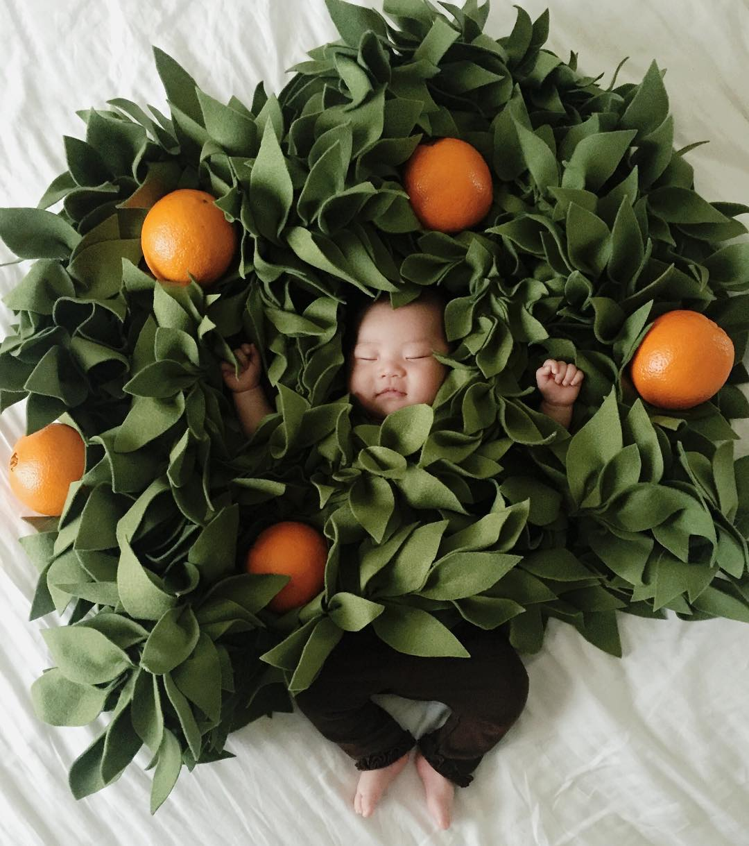 Baby and oranges
