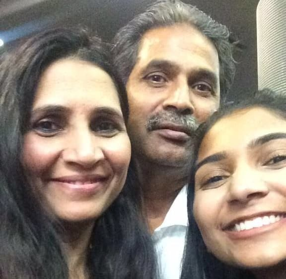 This is 18-year-old Iqra Hosain with her dad Syed and her mom Sadia. They live in Texas.