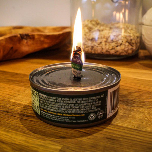Putting a wick in a tin of tuna will provide you with candlelight for hours, and the tuna will still be fine to eat afterward.