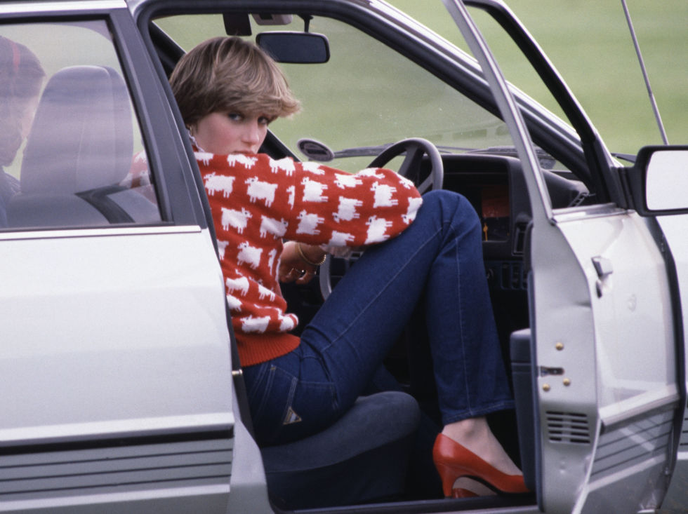 5. June 1981: Sitting in her car, wearing a checkered sweater and watching a polo match.