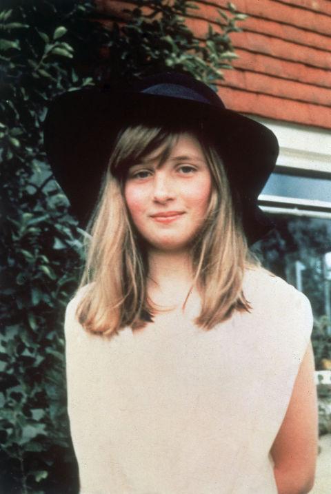 2. 1971: Spending summer in West Sussex, wearing a wide-brimmed felt hat.
