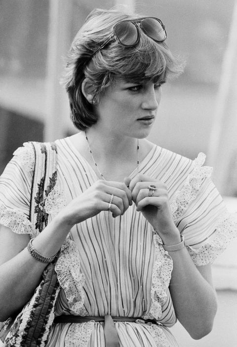 4. May 1981: Wearing a peasant top and plastic aviator sunglasses, Diana watching Prince Charles play polo.