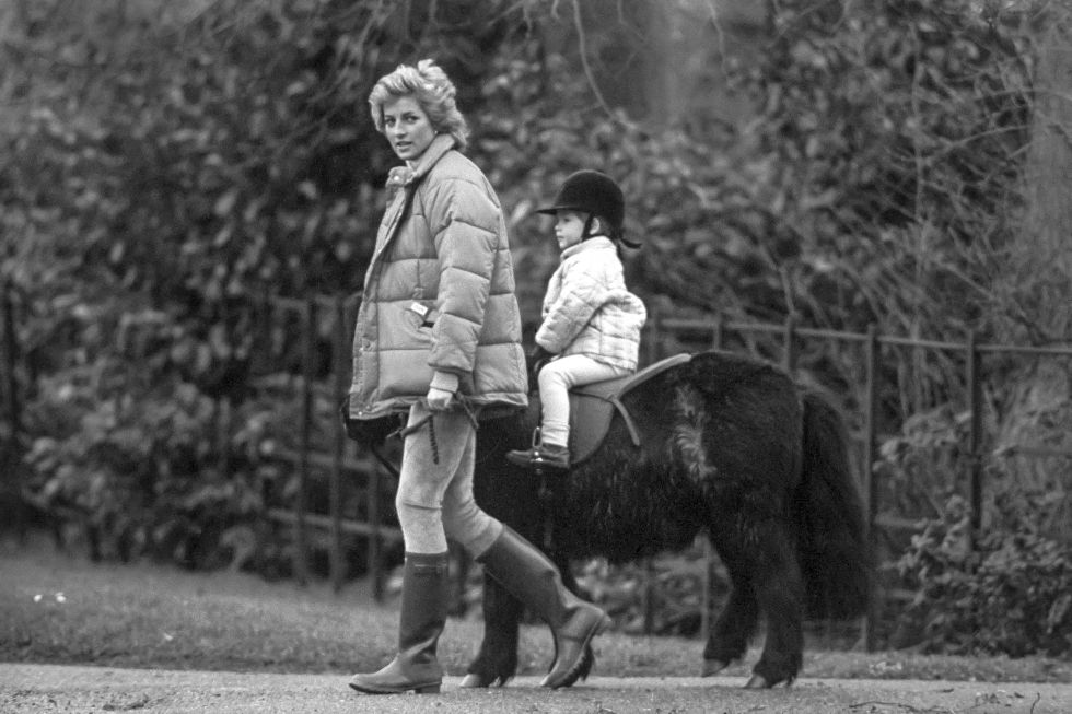 12. January 1988: Spending time with Prince Harry, while he is riding on a pony in Sandringham, UK.