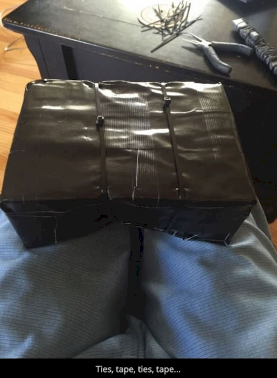he wrapped up the Wii in as many layers of tape and zip ties as he possibly could.