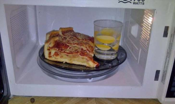 If you want to prevent the pizza crust from drying out as you reheat it, just put a glass of water in the microwave with it.