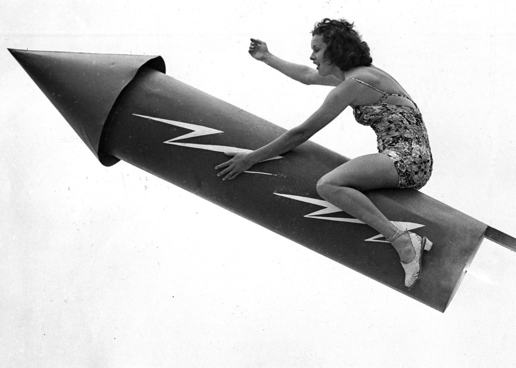 5. Riding a giant, human-sized bottle rocket, 1939.