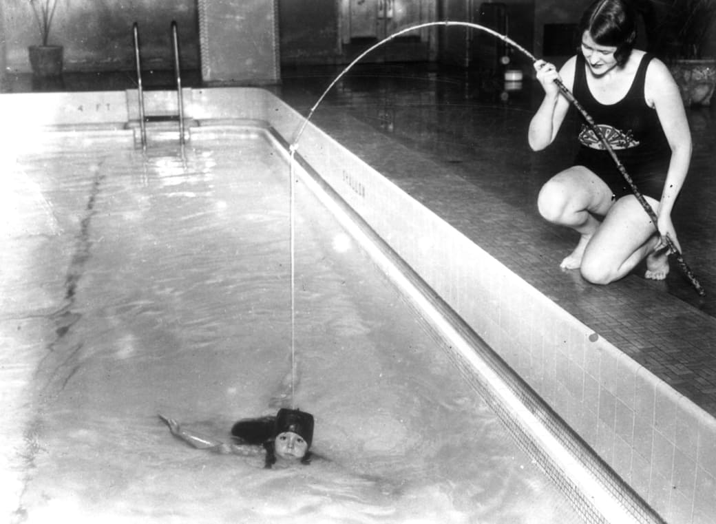 12. Teaching your children to swim with a fishing rod, 1926: