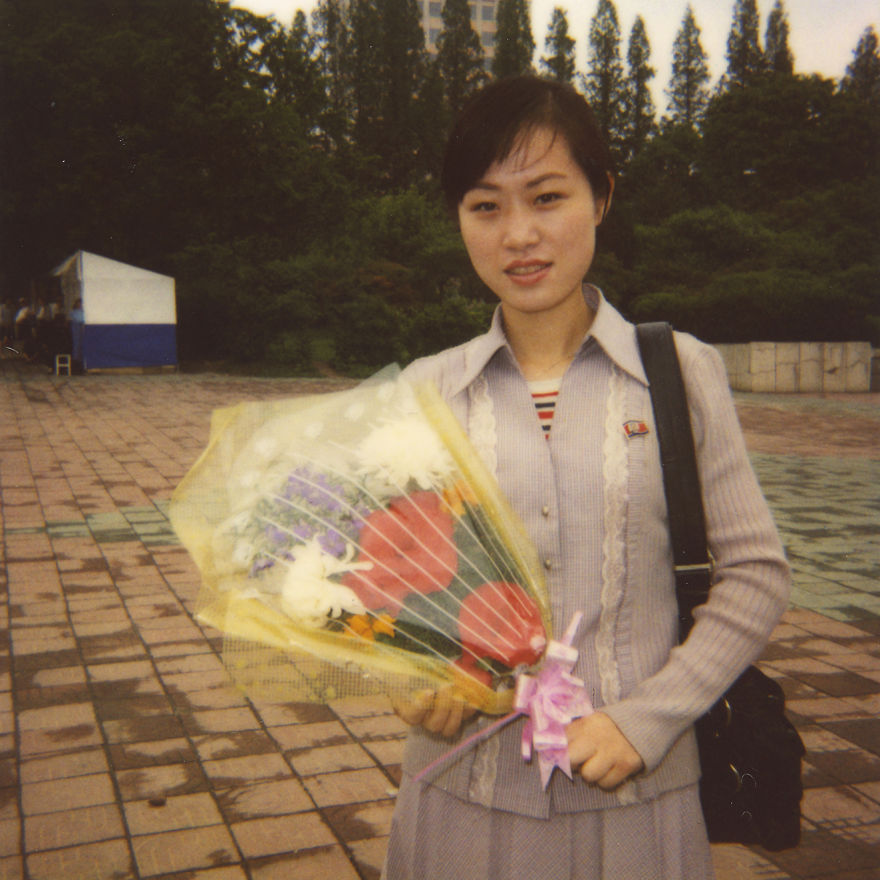 Her job is to sell some flowers that the visitors, including the tourists, will lay in front of the Leaders' statues in Mansudae hill in Pyongyang.