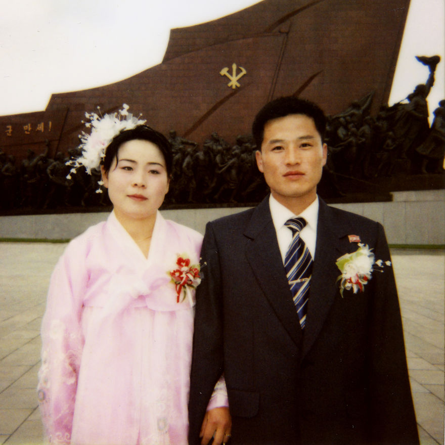 Every new couple comes to Mansudea hill to pay respect to the dear Leaders' statues in Pyongyang on the day of their wedding.