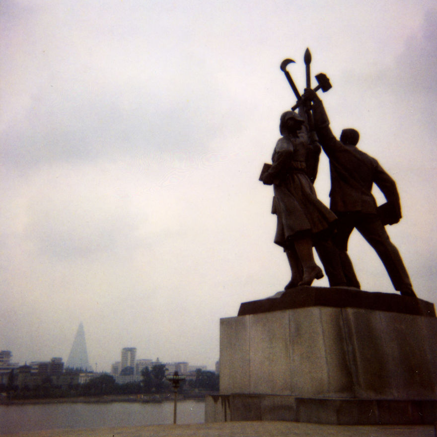 My guide asked me to throw away this Polaroid as I took the picture from the back. It is forbidden to take the picture with this angle in North Korea. Not respectful for the bronze heroes.