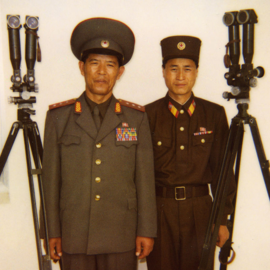 A North Korean colonel with a soldier on the DMZ, in the part where you can see South Korea through binoculars. First, he refused to pause, but when he saw the Polaroid of one soldier, he ordered me to take one of him too.
