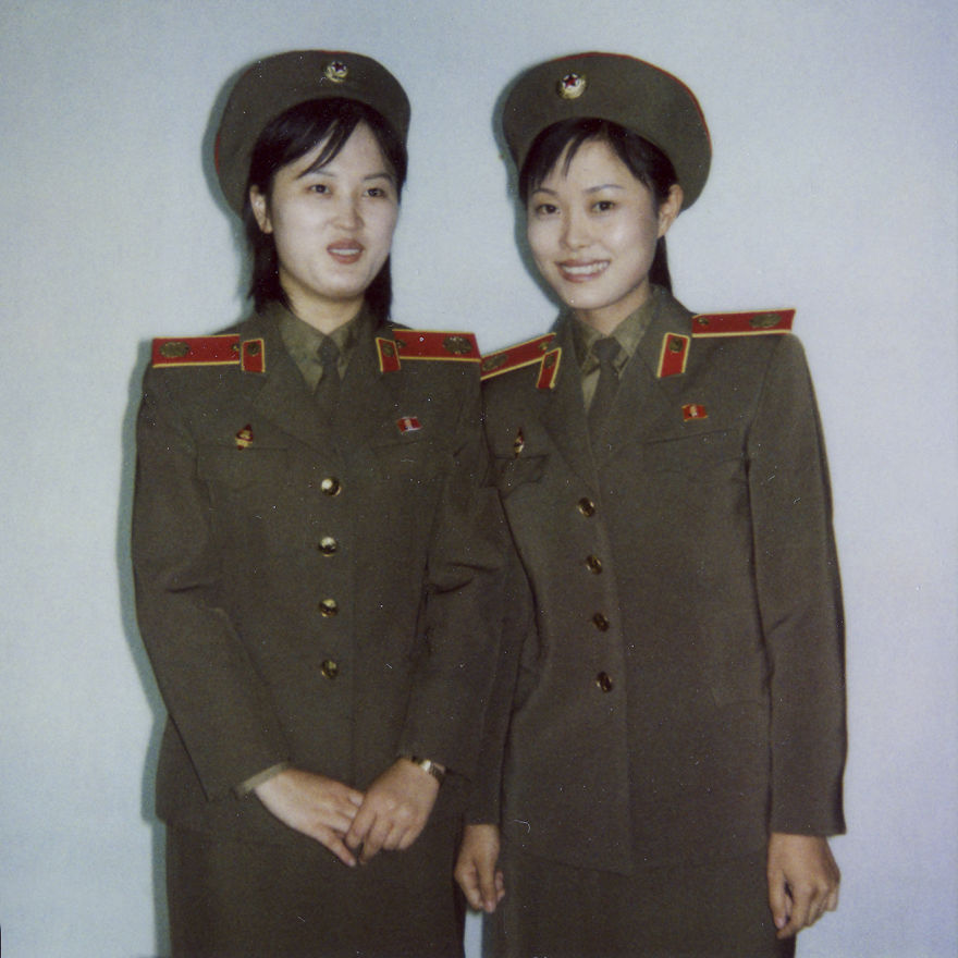 Two North Korean guides at the Victorious Fatherland Liberation War Museum (aka the War Museum) in Pyongyang.